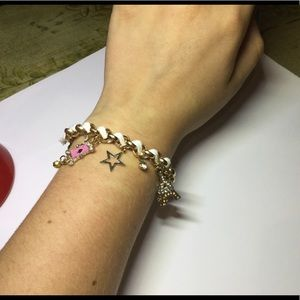 Gold and white charm bracelet w/ pink accents. New